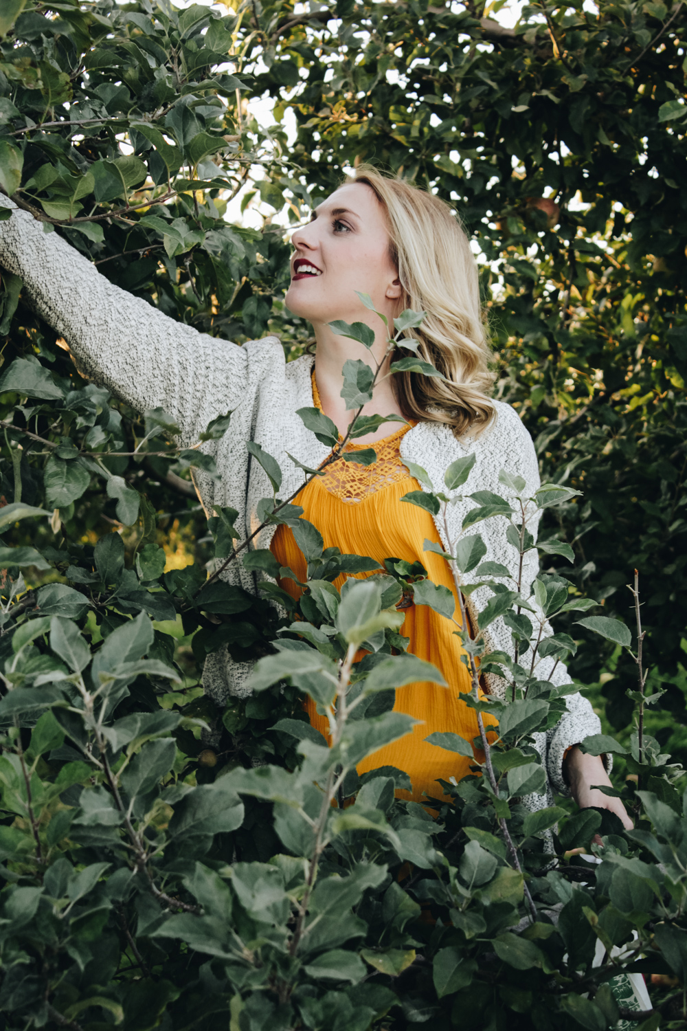 """In this """"He Said, She Said"""" post, we share our quite evening spent picking apples in cozy sweaters (both under $30!) at Simmons Farm outside of Pittsburgh."""