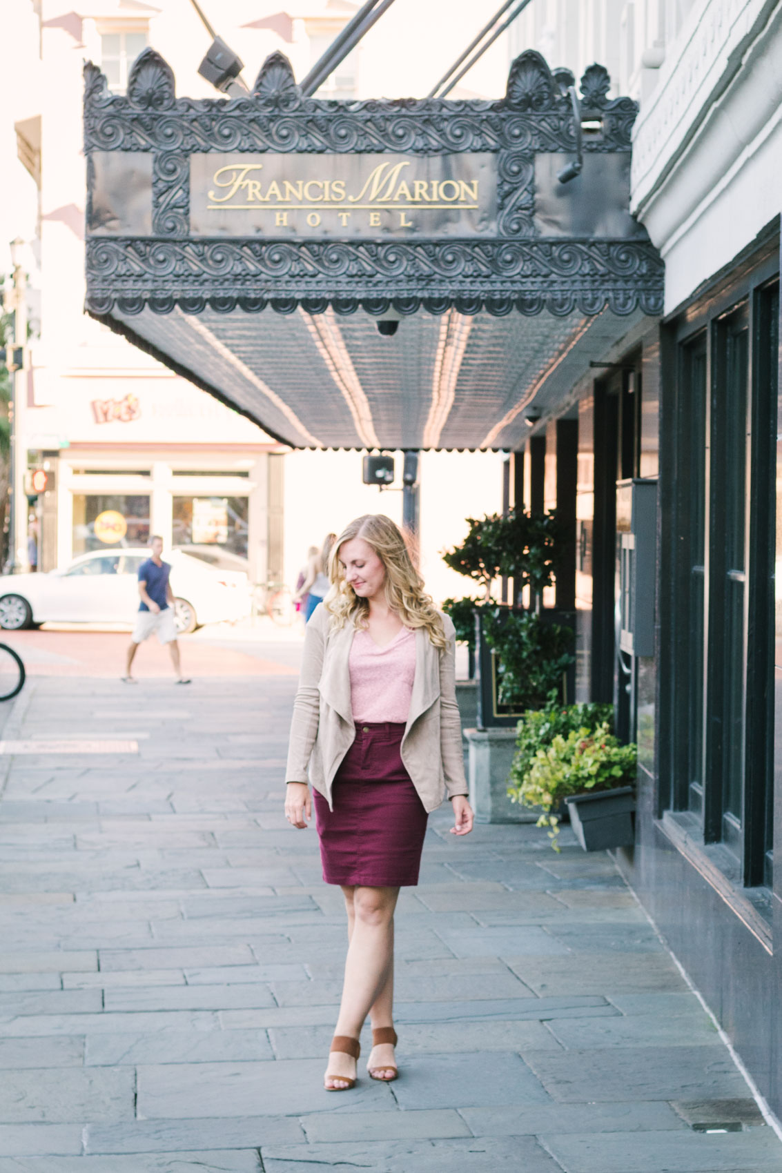 A burgundy skirt fall outfit at the Francis Marion Hotel Charleston, SC