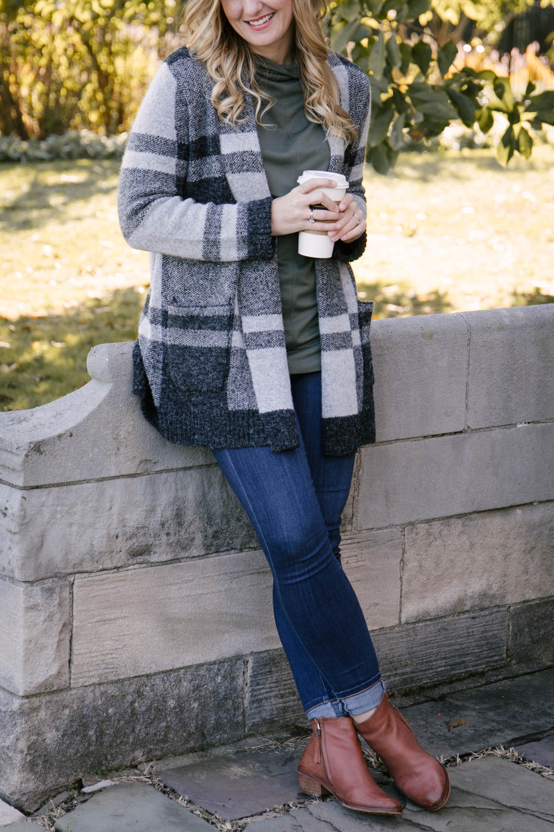 Allyn Lewis styles a long cardigan outfit fall with a plaid cardigan, skinny jeans, and ankle boots. | fall 2020 outfits, cute fall outfits